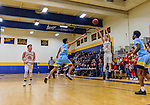 WATERBURY, CT. 14 March 2018-031418BS648 - Benjamin North (11) from Northwestern shoots a three point shot in front of the charging Kyle Federici (4) from Kolbe Cathedral in their Div IV semi-finals at Kennedy High School on Wednesday evening. Kolbe went on to defeat Northwestern and advanced to the finals at Mohegan Sun. Bill Shettle Republican-American