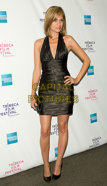 "TORREY DeVITTO.2008 Tribeca Film Festival - Premiere of ""Killer Movie"" at the AMC 19th Street Theater, New York, NY, USA..April 24th, 2008.full length black dress clutch bag hand on hip halterneck.CAP/LNC/TOM.©TOM/LNC/Capital Pictures."