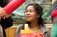 Socheata Mam, 19, creates paper lantern crafts at a Lunar New Year celebration at Middlesex Community College's Asian American Connections Center on Thurs., Feb. 15, 2018. Mam is a Cambodian-American first year student studying Criminal Justice. The Asian American Connections Center was established at the school using a federal grant in 2016 and serves as a focal point for the Asian community at the school, predominantly Cambodian, to gather, socialize, study, and otherwise take part in student life.