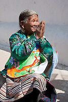 Bodhnath, Nepal.   Visitor at the Buddhist Stupa of Bodhnath, Making the Traditional Sign of Greeting, Namaste.