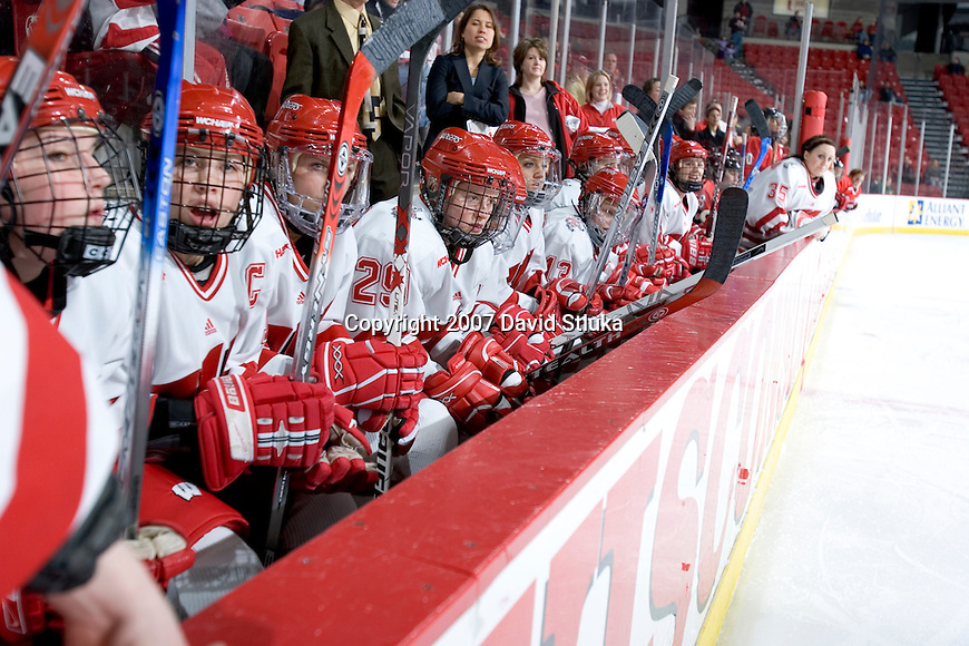 MADISON, WI - FEBRUARY 11: The Wisconsin Badgers women's hockey team look on during the game against the Ohio State Buckeyes at the Kohl Center on February 11, 2007 in Madison, Wisconsin. The Badgers beat the Buckeyes 3-2. (Photo by David Stluka)