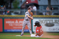 Grand Junction Rockies second baseman Turner Brown (31) throws to first base over Quincy McAfee (19) to complete a double play during a Pioneer League game against the Billings Mustangs at Dehler Park on August 14, 2019 in Billings, Montana. Grand Junction defeated Billings 8-5. (Zachary Lucy/Four Seam Images)