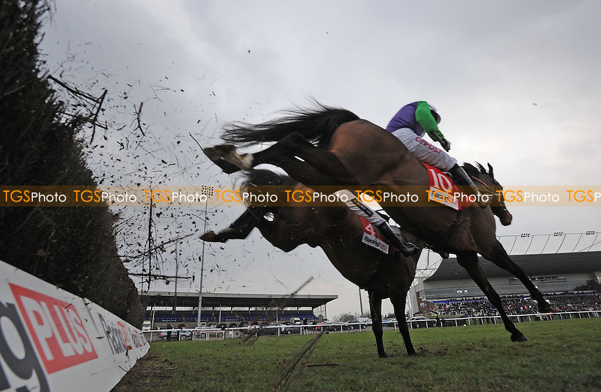 Opening Batsman ridden by Noel Fehily (left) takes the last from Rolling Aces and Ruby Walsh to win the Racing Plus Chase (Handicap) Grade 3 Cl1  - Horse Racing at Kempton Park Racecourse, Sunbury, Middlesex - 23/02/2013 - MANDATORY CREDIT: Martin Dalton/TGSPHOTO - Self billing applies where appropriate - 0845 094 6026 - contact@tgsphoto.co.uk - NO UNPAID USE.