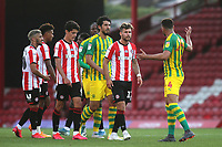 Brentford's Emiliano Marcondes and West Brom's Hal Robson-Kanu exchange words during Brentford vs West Bromwich Albion, Sky Bet EFL Championship Football at Griffin Park on 26th June 2020