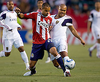 Chivas USA forward Maicon Santos (29) battles Real Salt Lake defender Robbie Russell (3). Real Salt Lake defeated CD Chivas USA 2-1at Home Depot Center stadium in Carson, California on Saturday May 22, 2010.  .