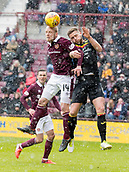 17th March 2018, Tynecastle Park, Edinburgh, Scotland; Scottish Premier League football, Heart of Midlothian versus Partick Thistle;  Steven Naismith of Hearts  and Daniel Devine of Partick Thistle challenge for the ball