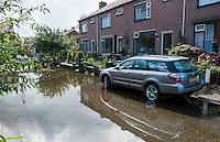 Nederland, Kockengen, 11 sept  2013<br /> In Kockengen zijn ernstige problemen met verzakkingen van de grond. Bij regen staan de straten snel blank en stinkt het naar rioollucht. <br /> Foto(c): Michiel Wijnbergh
