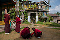 "India - Sikkim - Buddhist monks seen in the courtyard of the Pemayangtse Monastery. Planned, designed and founded by Lama Lhatsun Chempo in 1705, it is one of the oldest and premier monasteries of Sikkim, also the most famous in west Sikkim. Originally built by Lhatsun Chenpo in the 17th century, as a small Lhakhang, it was subsequently enlarged during the reign of the third Chogyal Chakdor Namgyal who was considered as Lhatsun Chenpo's third reincarnate, Jigme Pawo. The monastery follows the Nyingma Order of Tibetan Buddhism and controls all other monasteries of that Order in Sikkim. The monks of this monastery are normally chosen from the Bhutias of Sikkim.<br /> <br /> The monastery was built for ""pure monks"" (ta-tshang) meaning ""monks of pure Tibetan lineage"", celibate and without any physical abnormality. This practice is still retained. Only the monks of Pemayangtse Monastery are entitled to the title ""ta-tshang"". The head lama of this monastery had the unique privilege of anointing the Chogyals of the erstwhile monarchy of Sikkim with holy water."