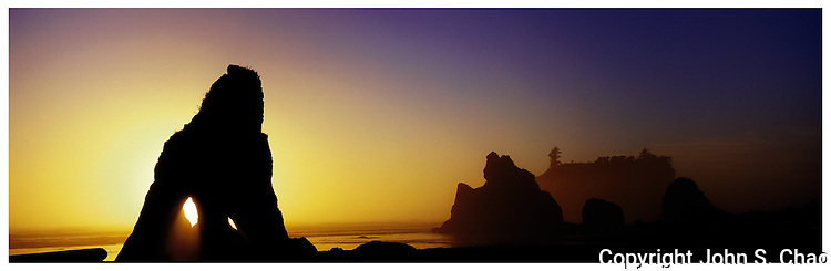 Rock seastacks silhouetted by sunset lighting at Ruby Beach, Olympic Coast National Marine Sanctuary, Washington State.....Photographed in X-Pan panoramic format on Velvia 100 film.