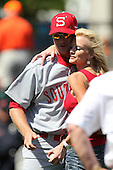 Florida Southern Lance Niekro gets a hug from his mom after she threw out the first pitch before a exhibition game vs. the Detroit Tigers at Joker Marchant Stadium in Lakeland, Florida;  February 25, 2011.  Detroit defeated Florida Southern 17-5.  Photo By Mike Janes/Four Seam Images