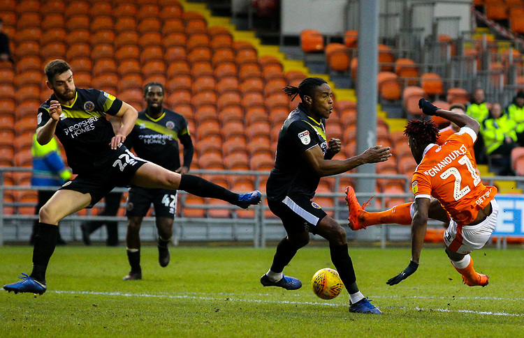 Blackpool's Armand Gnanduillet shoots at goal under pressure from Shrewsbury Town's Omar Beckles<br /> <br /> Photographer Alex Dodd/CameraSport<br /> <br /> The EFL Sky Bet League One - Blackpool v Shrewsbury Town - Saturday 19 January 2019 - Bloomfield Road - Blackpool<br /> <br /> World Copyright &copy; 2019 CameraSport. All rights reserved. 43 Linden Ave. Countesthorpe. Leicester. England. LE8 5PG - Tel: +44 (0) 116 277 4147 - admin@camerasport.com - www.camerasport.com