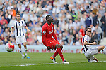 Christian Benteke of Liverpool reacts after missing a close-range opportunity to score during the Barclays Premier League match at The Hawthorns.  Photo credit should read: Malcolm Couzens/Sportimage