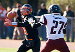 WATERTOWN, CT-112317JS06- Watertown's Nick D'Elia  (4) gets the pass of despite pressure from a Torrington defender during their Thanksgiving Day game Thursday at Watertown High School. <br /> Jim Shannon Republican-American
