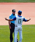 HARTFORD,  CT-071818JS06--Yard Goats manager Warren Schaeffer argues a call with an umpire during the Yard Goat's game against Reading Wednesday afternoon at Dunkin Donuts Park in Hartford.<br /> Jim Shannon Republican American