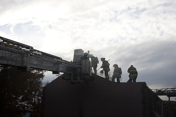 Firefighters work to put out a fire on Prospect Place in the Prospect Heights neighborhood of Brooklyn, New York on 10 November 2011.