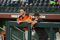 AZL Giants third baseman Jacob Gonzalez (52) and athletic trainer Eric Sanchez watch the action from the dugout during a game against the AZL Rangers on September 4, 2017 at Scottsdale Stadium in Scottsdale, Arizona. AZL Giants defeated the AZL Rangers 6-5 to advance to the Arizona League Championship Series. (Zachary Lucy/Four Seam Images)
