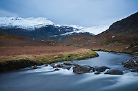 Snow covered mountains and river, Abhainn Sgaladail, Isle of Harris, Outer Hebrides, Scotland