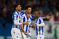 Kyel Reid (r) and Michael Mandron (l) celebrate with goalscorer Eli Phipps of Colchester United during Colchester United vs Cheltenham Town, Sky Bet EFL League 2 Football at the Weston Homes Community Stadium on 6th January 2018