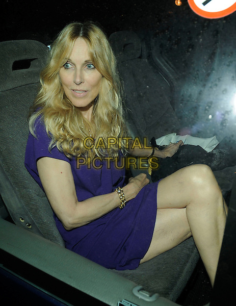 ALANA STEWART .At Kimberly Stewart's 30th birthday party,  Beach Blanket Babylon, Ledbury Road, London, England, UK, .August 20th 2009..half length purple blue dress sitting in car shot mother mum mom 3/4 legs crossed gold bracelets .CAP/CAN.©Can Nguyen/Capital Pictures