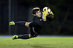 18 October 2013: North Carolina's Brendan Moore catches the ball while making a diving save. The University of North Carolina Tar Heels hosted the Syracuse University Orangemen at Fetzer Field in Chapel Hill, NC in a 2013 NCAA Division I Men's Soccer match. UNC won the game 1-0.