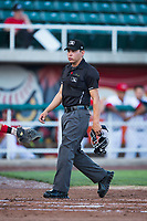 Home plate umpire Rene Gallegos during a Pioneer League game between the Orem Owlz and the Ogden Raptors at Home of the OWLZ on August 24, 2018 in Orem, Utah. The Ogden Raptors defeated the Orem Owlz by a score of 13-5. (Zachary Lucy/Four Seam Images)