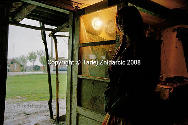 Girl at home in Roma settlement. Balteni, Romania.
