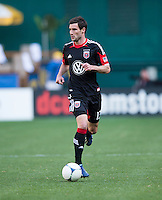 Chris Pontius (13) of D.C. United brings the ball upfield during the game at RFK Stadium in Washington, DC.  Columbus Crew defeated D.C. United, 2-1.