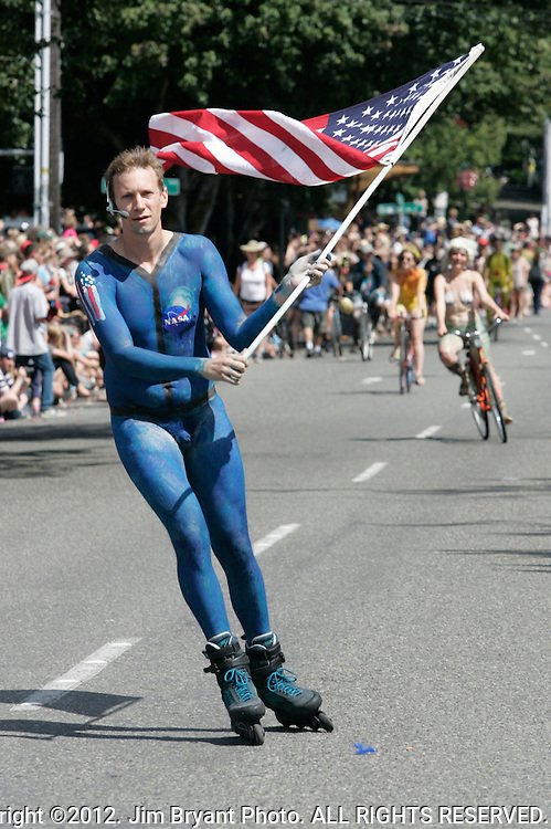 Painted nude participant waves the U.S. Flag as he skates during the 25th  Annual Fremont Summer Solstice Parade in Seattle on JJune 22, 2013.      UPI Photo/Jim BryantPainted nude bicyclists  ride during the 25th  Annual Fremont Summer Solstice Parade in Seattle on June 22, 2013.     ©2013.  Jim Bryant.  ALL RIGHTS RESERVED.