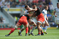 Luke Cowan-Dickie of Exeter Chiefs is tackled by George Kruis and Billy Vunipola of Saracens during the Aviva Premiership Rugby Final between Saracens and Exeter Chiefs at Twickenham Stadium on Saturday 28th May 2016 (Photo: Rob Munro/Stewart Communications)