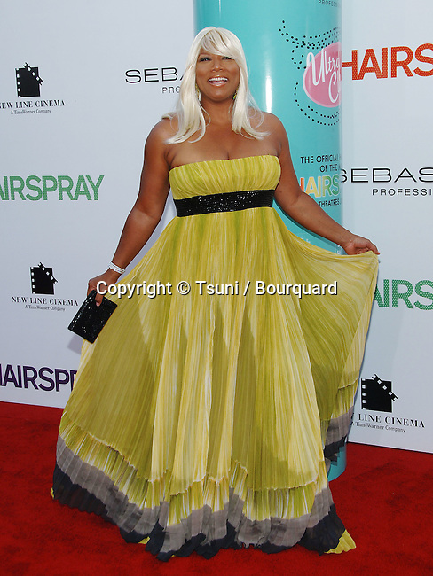 Queen Latifah arriving at the HAIRSPRAY Premiere at the Westwood Village Theatre in Los Angeles.<br /> <br /> full length<br /> eye contact<br /> smile<br /> blond wig<br /> yellow dress