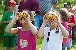 Two girls looking for birds with colorful binoculars