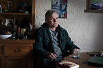 'Mike MacKenzie at home, 2019' from Colin McPherson's project 'Treasured Island' part of the Document Scotland exhibition entitled 'A Contested Land' which will launch at the Martin Parr Foundation, Bristol, on 16th January, 2019. McPherson's work was made in 2018-2019 on Easdale, the smallest permanently inhabited Inner Hebridean island and looks at the historical legacy of the island, once world famous for its slate mining industry.<br /> <br /> Photograph © Colin McPherson, 2019 all rights reserved.