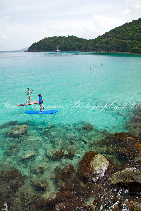 Stand up paddleboarders<br /> Hawksnest Bay / Gibney Beach<br /> Virgin Islands National Park<br /> St. John, U.S. Virgin Islands