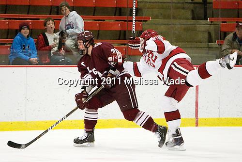 Jeremy Price (Colgate - 20), David Valek (Harvard - 22) - The Harvard University Crimson defeated the visiting Colgate University Raiders 6-2 (2 EN) on Friday, January 28, 2011, at Bright Hockey Center in Cambridge, Massachusetts.