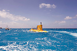 Photo shows the yellow submarine Deepstar about to descend into the lagoon on the west coast of Saipan..Robert Gilhooly Photo