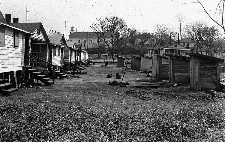 Privies behing houses in a black section of Montgomery, Ala. This and over 10,000 other images are part of the Jim Peppler Collection at The Alabama Department of Archives and History:  http://digital.archives.alabama.gov/cdm4/peppler.php