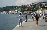 Fisherman and strollers along the banks of the Bosphorous Sea in Istanbul, Turkey