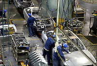 Chinese workers put together the body for a Buick at the Shanghai General Motors (SGM) plant in Shanghai, China. SGM is a joint-venture between General Motors and the Shanghai Automotive Industry Corporation also known as SAIC..