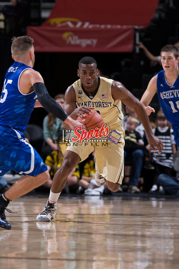 Codi Miller-McIntyre (0) of the Wake Forest Demon Deacons pushes the ball up the court during first half action against the UNC Asheville Bulldogs at the LJVM Coliseum on November 14, 2014 in Winston-Salem, North Carolina.  The Demon Deacons defeated the Bulldogs 80-69  (Brian Westerholt/Sports On Film)