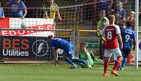 Wimbledon's Joe Pigott scores the only goal of the game past a grounded Fleetwood Town goalkeeper Alex Cairns<br /> <br /> Photographer Stephen White/CameraSport<br /> <br /> The EFL Sky Bet League One - Fleetwood Town v AFC Wimbledon - Saturday 4th August 2018 - Highbury Stadium - Fleetwood<br /> <br /> World Copyright &copy; 2018 CameraSport. All rights reserved. 43 Linden Ave. Countesthorpe. Leicester. England. LE8 5PG - Tel: +44 (0) 116 277 4147 - admin@camerasport.com - www.camerasport.com