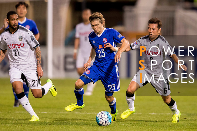 Jaimes McKee (2nd right) of Eastern SC (HKG) battles for the ball with Yusuke Tasaka (r) and Kentaro Moriya of Kawasaki Frontale (JPN) during the AFC Champions League 2017 Group G match between Eastern SC (HKG) and Kawasaki Frontale (JPN) at the Mongkok Stadium on 01 March 2017 in Hong Kong, China. Photo by Chris Wong / Power Sport Images