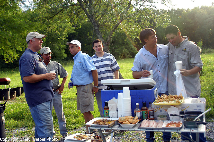 Jeff Tunks, Nash Roberts, Justin Frey, Randy Pierce, John Besh, and Greg Reggio gathered for outdoor cookout before frog hunt, June 29, 2005..(Cheryl Gerber Photo)