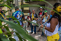 RIO DE JANEIRO, BRAZIL - FEBRUARY 22, 2014: Outpatients play the drums during a practice session for the annual T&aacute; Pirando, Pirado, Pirou! carnival street parade at the Instituto Philippe Pinel psychiatric hospital on February 22, 2014 in Rio De Janeiro, Brazil. It looks like any of the other 450 or so street parties, locally called &ldquo;carnival blocks,&rdquo; that parade through Rio de Janeiro during the raucous pre-Lenten festivities that draw hundreds of thousands to the city each year. What makes this party different are its performers and organizers: psychiatric patients and their doctors, therapists, family members, neighbors and passers-by. The group, called T&aacute; Pirando, Pirado, Pirou!, which roughly translates as &ldquo;We&rsquo;re freaking out, we already freaked out!&rdquo;, began ten years ago when Brazil was in the process of dismantling its century-old system of mental asylums. A law passed in 2001 called for long-term outpatient psychiatric care to be offered primarily in community clinics. The number of such clinics increased more than fivefold in the following decade, while the number of asylum beds for psychiatric patients dropped 40 percent nationwide.<br /> <br /> Daniel Berehulak for The New York Times