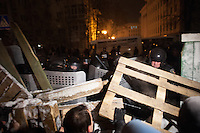 Protesters protect the barricades in the government district while the police begins to dismantle piece by piece the defense structures. Kiev. Ukraine