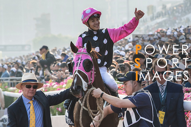 Jockey Derek K C Leung riding Beauty Generation celebrates with trainer John Moore after winning the Longines Hong Kong Mile (G1, 1600m) during the Longines Hong Kong International Races at Sha Tin Racecourse on December 10 2017, in Hong Kong, Hong Kong. Photo by Victor Fraile / Power Sport Images