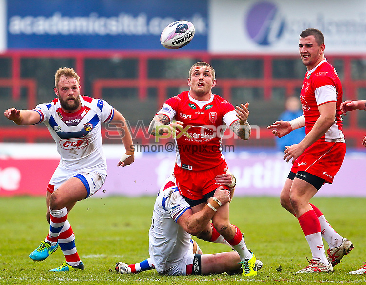 Picture by Alex Whitehead/SWpix.com - 30/03/2014 - Rugby League - First Utility Super League - Hull Kingston Rovers v Wakefield Trinity Wildcats - KC Lightstream Stadium, Hull, England - Hull KR's Ben Cockayne is tackled by Wakefield's Matty Ryan.