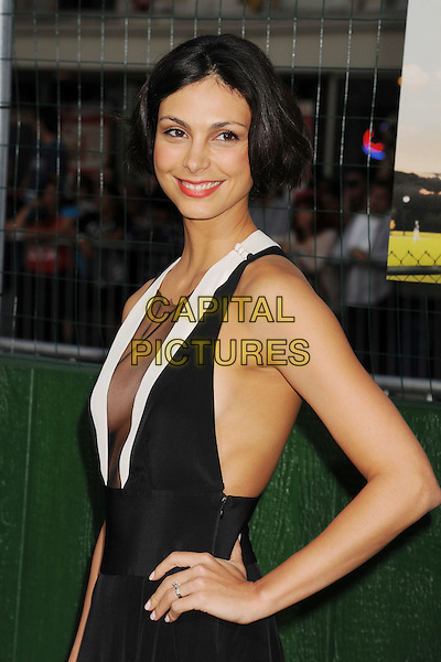 "Morena Baccarin.""Trouble With The Curve"" Los Angeles Premiere held at the Regency Village Theatre, Westwood, California, USA..September 19th, 2012.half length white hand on hip dress sleeveless plunging neckline cleavage sheer black hand on hip side .CAP/ROT/TM.©Tony Michaels/Roth Stock/Capital Pictures"