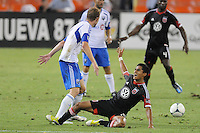 D.C. United midfielder Andy Najar (14) gets fouled by Montreal Impact midfielder Justin Mapp (21) D.C. United defeated Montreal Impact 3-0 at RFK Stadium, Saturday June 30, 2012.