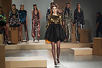 Model walks runway in a gold sequin ORDELL dress with black silk wool teacup style skirt, black tulle CRINOLINE, from the Greta Constantine Spring Summer 2018 collection by Kirk Pickersgill and Stephen Wong on September 6, 2017; at Pier 59 Studios during New York Fashion Week. Horizontal