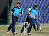 Early sucess for Scotland, with Gordon Drummond celebrating a wicket with capt Gavin Hamilton (right) in their T20 World Cup Qualifying match against Afghanistan in Abu Dhabi - Picture by Donald MacLeod 10.02.10